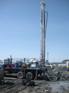 Drill rig installing vertical heat exchanger